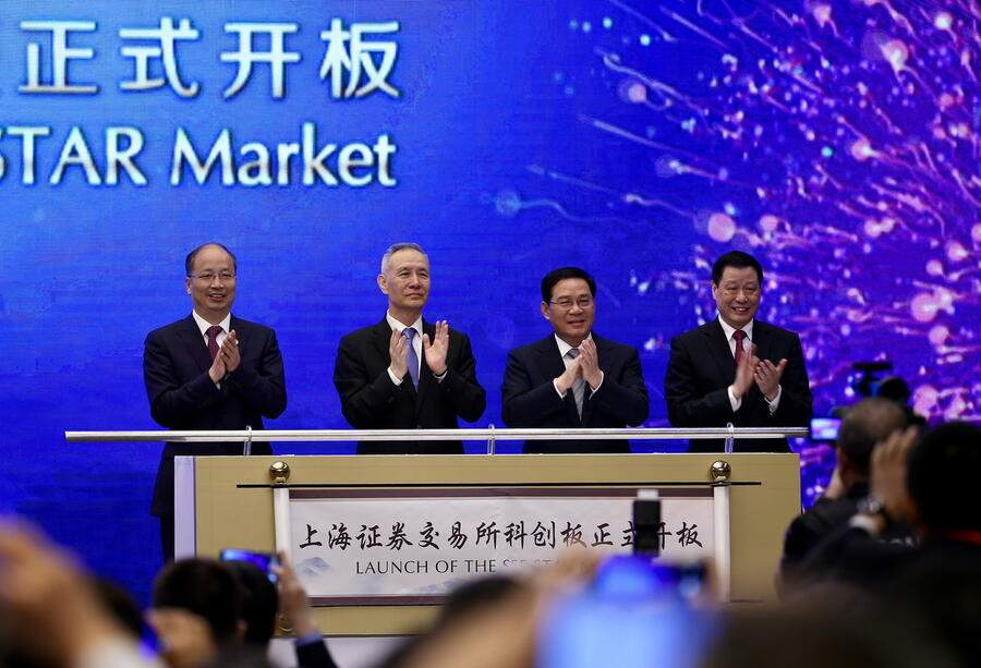 epa07644933 (L-R) Yi Huiman, Chairman of China Securities Regulatory Commission, Liu He, Vice Premier, Li Qiang, top Party official of Shanghai, and Ying Yong, Shanghai's mayor, celebrate the launch of the SSE STAR Market, previously referred to as the Shanghai Stock Exchange science and technology innovation board, in Shanghai, China, 13 June 2019. The board will commence trading within two months. EPA/FEATURECHINA CHINA OUT