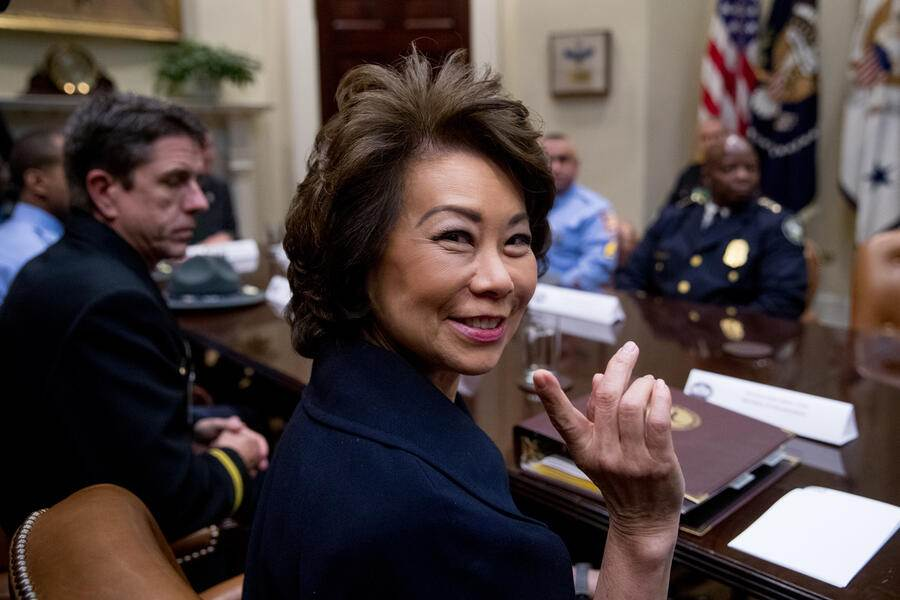Transportation Secretary Elaine Chao speaks to first responders from the I-85 bridge collapse in Atlanta as they wait for President Donald Trump in the Roosevelt Room in the White House, Thursday, April 13, 2017, in Washington. (AP Photo/Andrew Harnik)