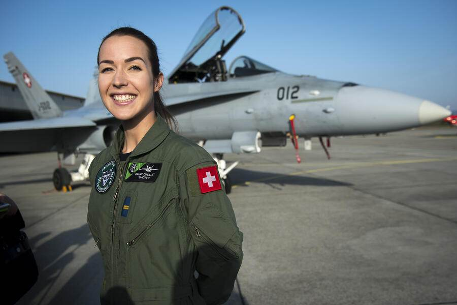 Fanny Chollet, the first female fighter pilot of the Swiss air force poses in front of a F/A-18 Hornet fighter jet after a press conference at the Swiss army airbase in Payerne, Tuesday, February 19, 2019. (KEYSTONE/Laurent Gillieron)
