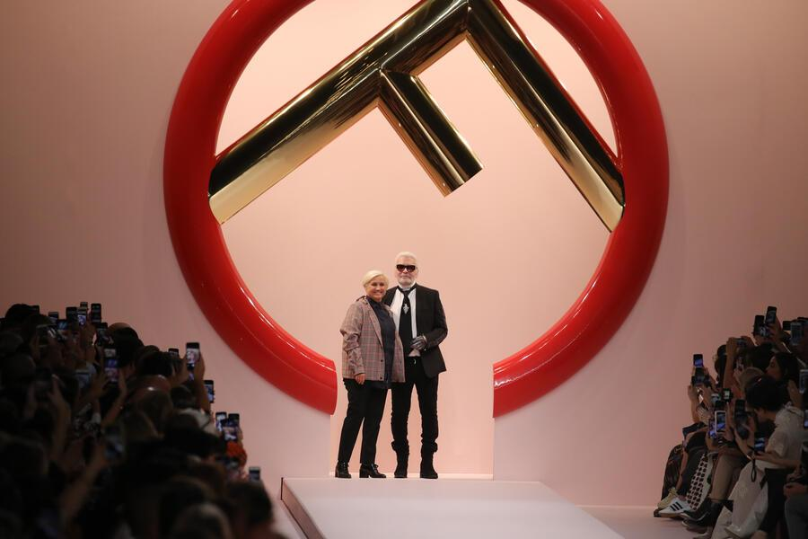 MILAN, ITALY - SEPTEMBER 20:  Italian designer Silvia Venturini Fendi and German fashion designer Karl Lagerfeld acknowledge the applause of the audience at the Fendi show during Milan Fashion Week Spring/Summer 2019 on September 20, 2018 in Milan, Italy.  (Photo by Andreas Rentz/Getty Images)