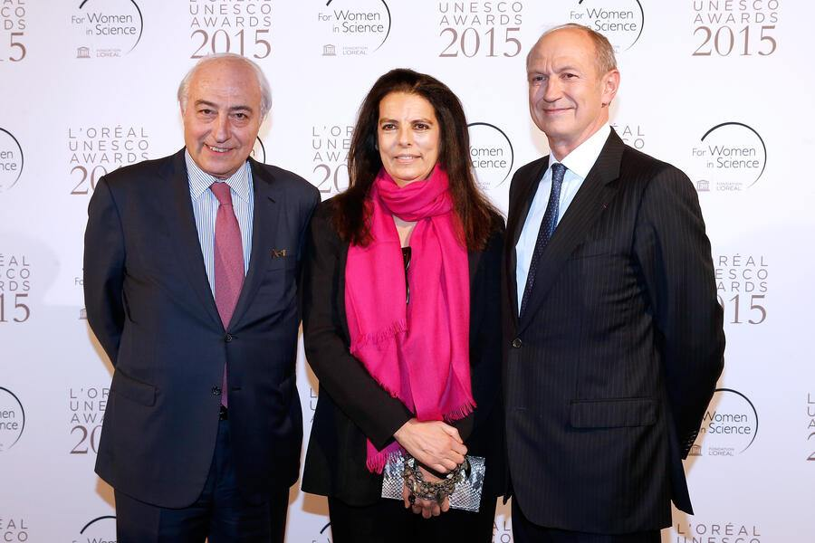 PARIS, FRANCE - MARCH 18:  Francoise Bettencourt Meyers standing between her husband Jean-Pierre Meyers (L) and Chairman & Chief Executive Officer of L'Oreal and Chairman of the L'Oreal Foundation Jean-Paul Agon (R) attend the 'L'Oreal-UNESCO Awards 2015 for Women in Science at La Sorbonne on March 18, 2015 in Paris, France.  (Photo by Bertrand Rindoff Petroff/Getty Images)