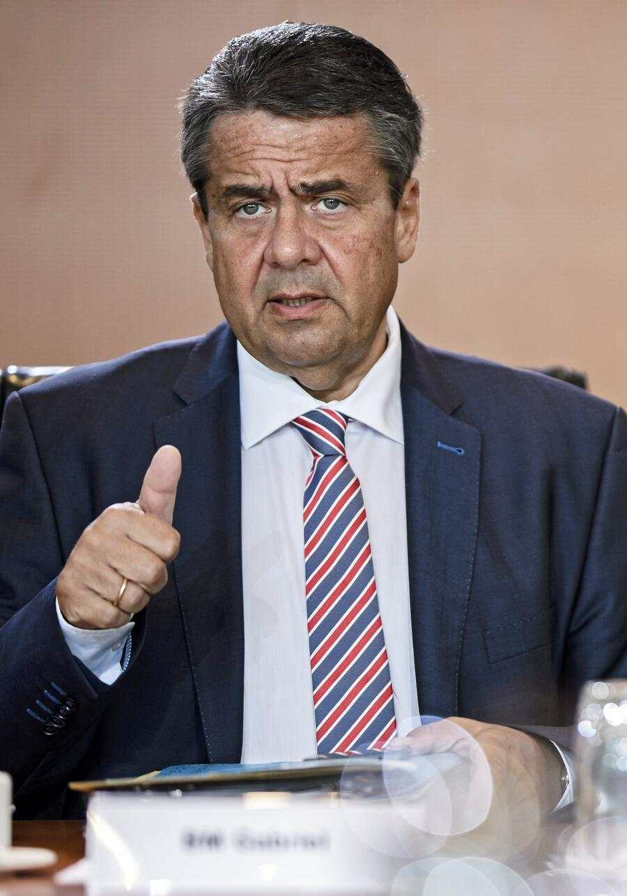 epa06187148 German Foreign Minister Sigmar Gabriel gestures prior the beginning of the weekly cabinet meeting in Berlin, Germany, 06 September 2017. The cabinet is expected to discuss the Annual Report on the Status of German Unity 2017, among other topics.  EPA/CLEMENS BILAN