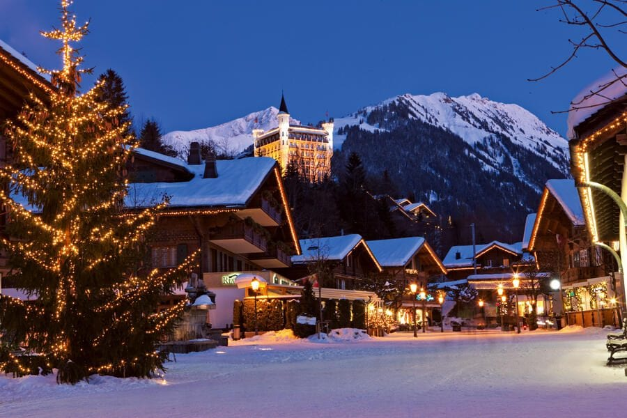 The Gstaad Palace is perched above the festively illuminated village of Gstaad in the Saanenland / Bernese Oberland.Schweiz. ganz natuerlich. Das Gstaad Palace thront ueber dem festlich illuminierten Dorf im Saanenland / Berner Oberland. Suisse. tout naturellement. Oberland bernois. Le Gstaad Palace est perche au-dessus du village festive illumine.Copyright by: Switzerland Tourism - By-Line: swiss-image.ch/ Christof Sonderegger