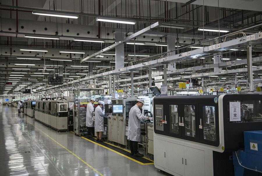 Workers are seen on the production line at Huawei's production campus on April 11, 2019 in Dongguan, near Shenzhen, China.