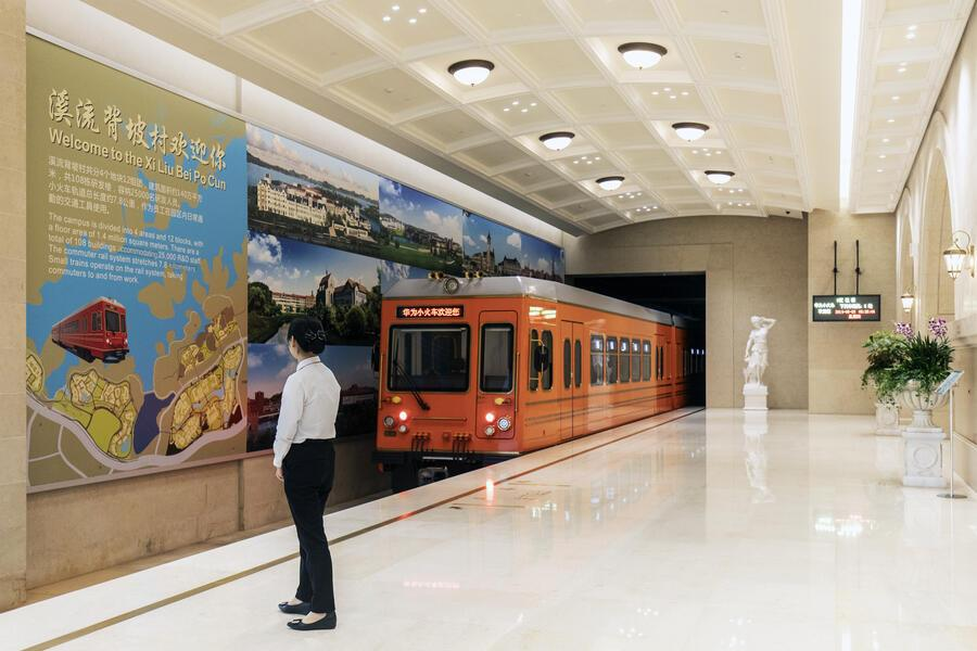 A shuttle train departs a station at the Huawei Technologies Co. Ox Horn research and development campus in Dongguan, China, on Thursday, May 23, 2019. Huaweiis seeking about $1 billion from a small group of lenders, its first major funding test after getting hit with U.S. curbs that threaten to cut off access to critical suppliers. Photographer: Qilai Shen/Bloomberg