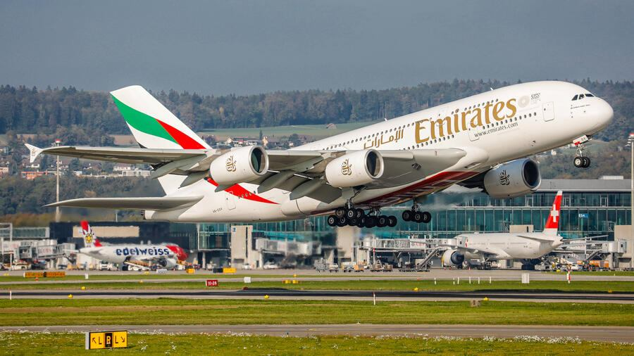 Zurich, Switzerland - 9th October 2018: An Emirates Airbus A380-861 takes off from runway 16 at Zurich Airport. The largest passenger aircraft in the world, with registration A6-EOV, has been in service since February 2016 for the airline of the United Arab Emirates. The photo was taken outside the airport. Aircrafts