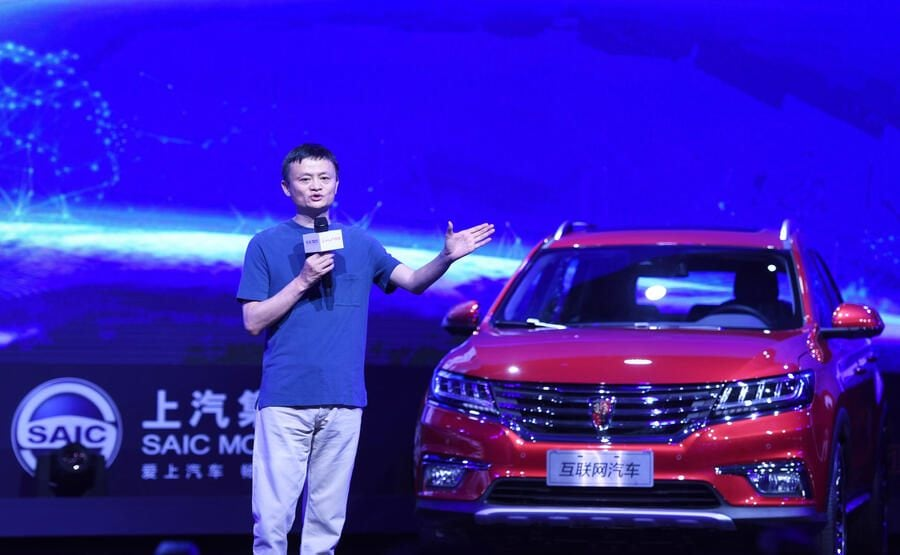 """HANGZHOU, CHINA - JULY 06: Alibaba founder and chairman Jack Ma delivers a speech at the unveiling ceremony of Alibaba's first internet car SAIC Roewe RX5 on July 6, 2016 in Hangzhou, Zhejiang Province of China. Two of China's biggest household brands Alibaba Group and SAIC Motor have created what they call """"the world's first mass-produced car on the internet - Roewe RX5."""" (Photo by VCG/VCG via Getty Images)"""