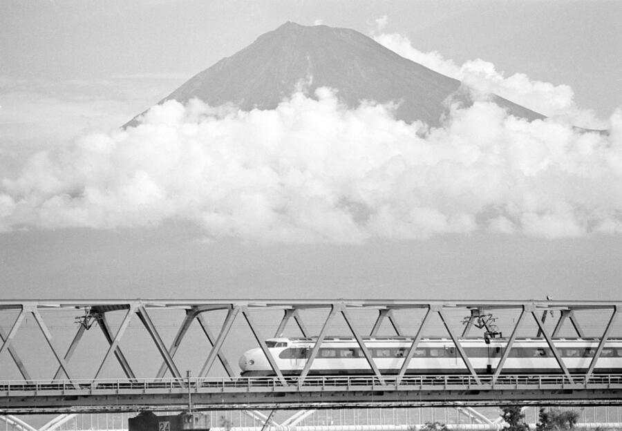 FILE - In this Oct. 1982 file, Japan's Shinkansen, high speed train, travels past Mount Fuji, crossing over the Fuji River, west of Tokyo. Zipping cross-country in a super-high speed train has become commonplace in many countries these days, but it was unheard of when Japan launched its bullet train between Tokyo and Osaka 50 years ago Wednesday, Oct. 1, 2014. (AP Photo/Fie)