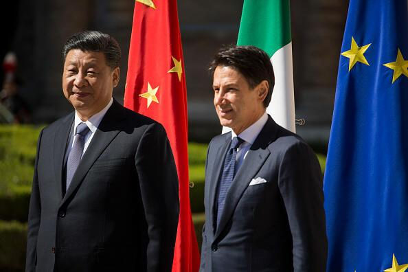 Italys Prime Minister Giuseppe Conte (R) and China's President Xi Jinping (L) pose for photographers during a welcoming ceremony upon Xi Jinping's arrival for their meeting at Villa Madama in Rome on March 23, 2019 as part of a two-day visit to Italy. President Xi Jinping is in Italy to sign a memorandum of understanding to make Italy the first Group of Seven leading democracies to join China's ambitious Belt and Road infrastructure project. (Photo by Christian Minelli/NurPhoto via Getty Images)