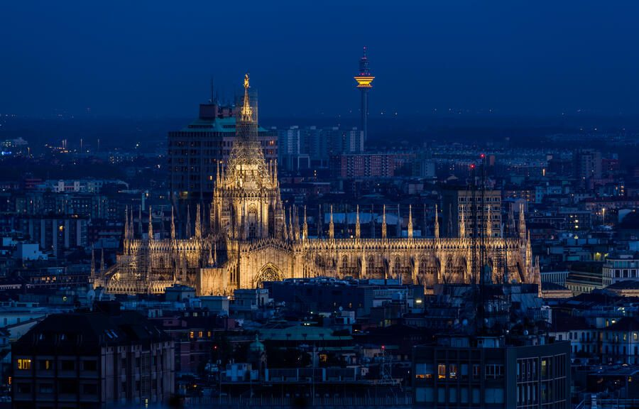 Aerial view of Duomo di Milano illuminated at dusk