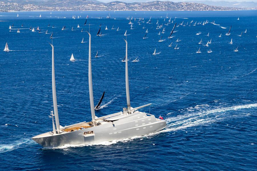 """SAINT-TROPEZ, FRANCE - JUNE 12, 2019 : One of the world's largest Sailing Yacht called """"White Pearl"""" or """"Sailing Yacht A"""" passes by the fleet of the offshore Rolex Giraglia sailing race, on June 12, 2019, off Saint-Tropez, France. (Photo by Studio Borlenghi/ALeA/Getty Images)"""