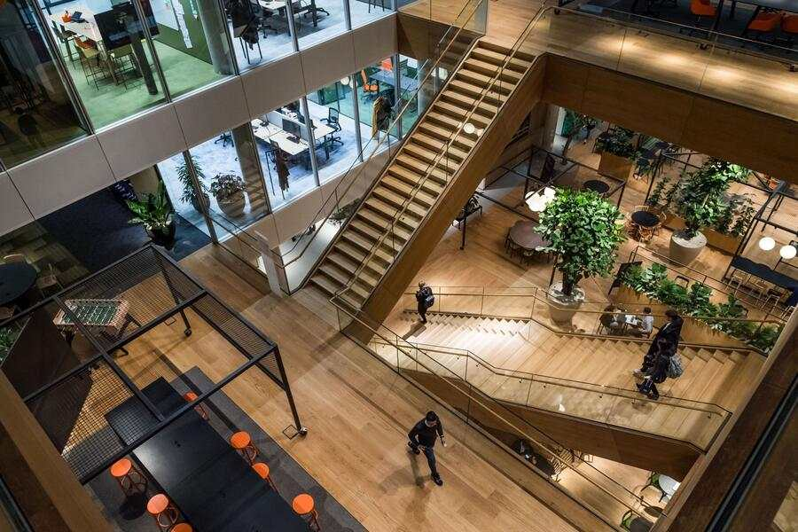 Attendees descend the central atrium staircases inside the new ING Groep NV Cedar campus headquarters at Cumulus Park in Amsterdam, Netherlands, on Tuesday, Jan. 7, 2020. The Dutch bank is scheduled to report full year earnings on February, 6. Photographer: Geert Vanden Wijngaert/Bloomberg