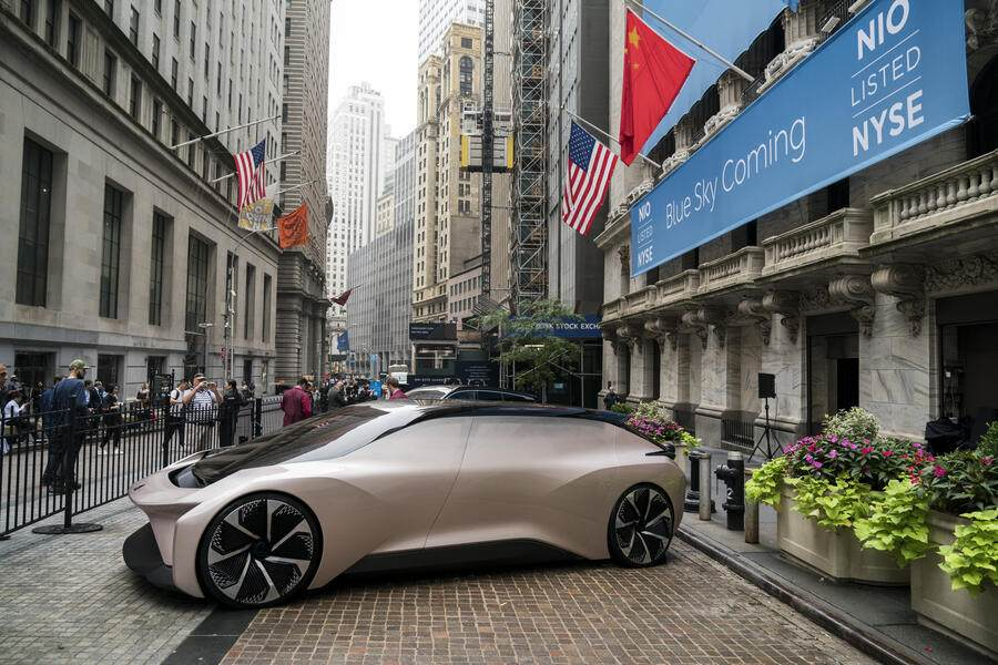 NEW YORK, NY - SEPTEMBER 12: A vehicle from electric car maker NIO sits outside of the New York Stock Exchange (NYSE), September 12, 2018 in New York City. The Shanghai-based electric car company opened for trading at $6 per share. (Photo by Drew Angerer/Getty Images)