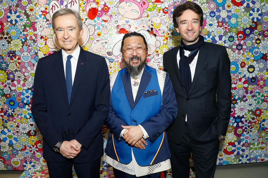 """PARIS, FRANCE - APRIL 09:  (L-R) Owner of LVMH Luxury Group and President of the Louis Vuitton Foundation, Bernard Arnault, Japanese Artist Takashi Murakami and General manager of Berluti Antoine Arnault attend """"Au Diapason Du Monde"""" Exhibition at Fondation Louis Vuitton on April 9, 2018 in Paris, France.  (Photo by Julien M. Hekimian/Getty Images)"""