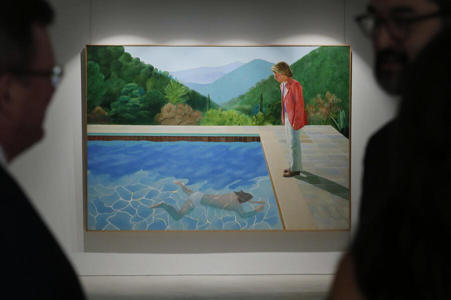 "Visitors watch the painting ""Portrait of an artist (pool with two figures)"" by David Hockney during a media preview by the Christie's auction house in Hong Kong Thursday, Sept. 27, 2018. The painting is expected to fetch US$80 million at the Christie's New York evening sale in November. (AP Photo/Kin Cheung)"