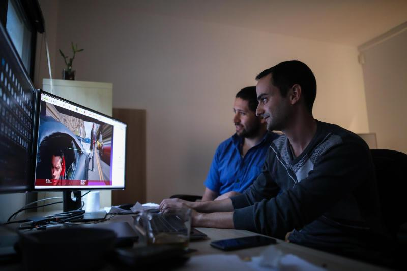 Researchers Shachar Honig (left), 35, and Sarel Duanis (right), 29, look at videos and effects in an office at Lightricks, a startup that creates applications for photo and video editing, in Jerusalem, February 28, 2019.