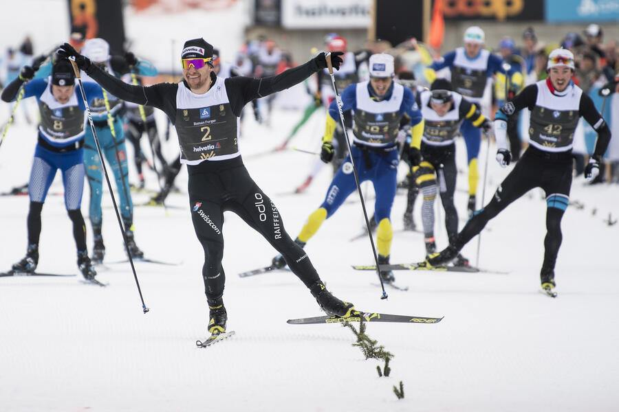 Roman Furger of Switzerland, winner, celebrates after the Engadin skiing marathon in the finish area in S Chanf, on Sunday, March 11, 2018. (KEYSTONE/Peter Schneider)
