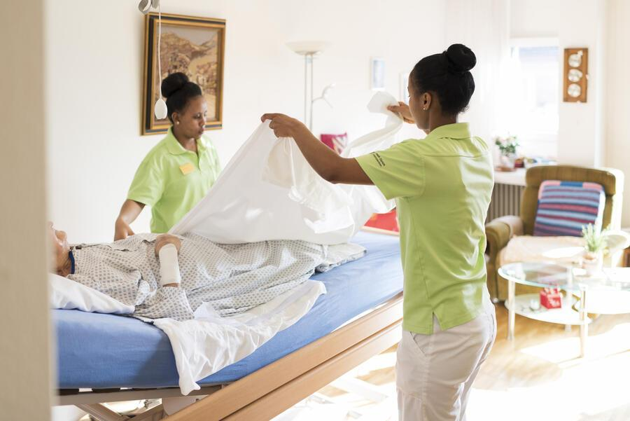 Nurses wash and dress a resident of the retirement home Herzogenmuehle in Zurich, Switzerland, on February 21, 2019. (KEYSTONE/Christian Beutler)