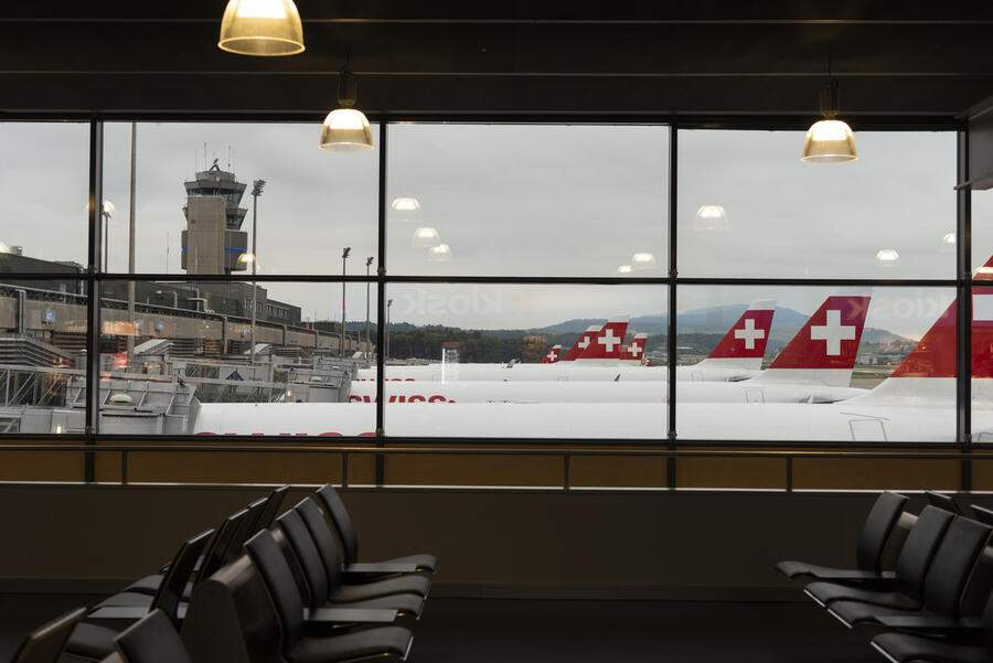 Parked Swiss International Air Lines airplanes at Zurich Airport in Kloten, Switzerland, photographed from the waiting area of the airport on May 20, 2018. (KEYSTONE/Christian Beutler)