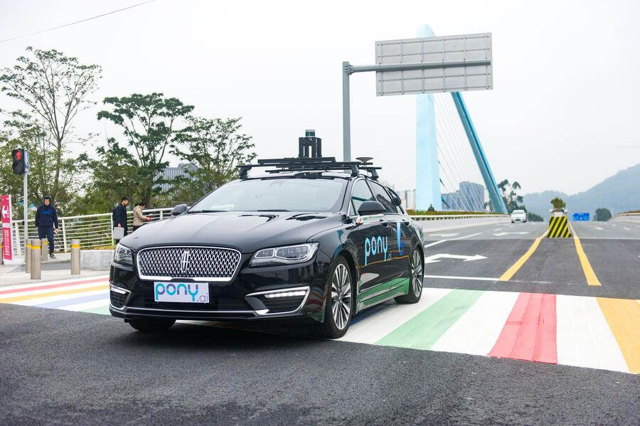 GUANGZHOU, CHINA - FEBRUARY 02:  Pony.ai self-driving cars run along a road during a trial run on February 2, 2018 in Guangzhou, China. Pony.ai, a year-old California-based self-driving car startup, will set up a fleet of self-driving cars to serve the public in Guangzhou.  (Photo by Liao Shupei/China News Service/VCG via Getty Images)
