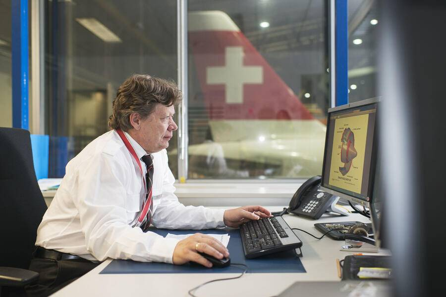 An employee prepares a maintenance at the aircraft maintenance center at Zurich Airport in Kloten in the Canton of Zurich, Switzerland, pictured on July 22, 2014. (KEYSTONE/Christian Beutler)