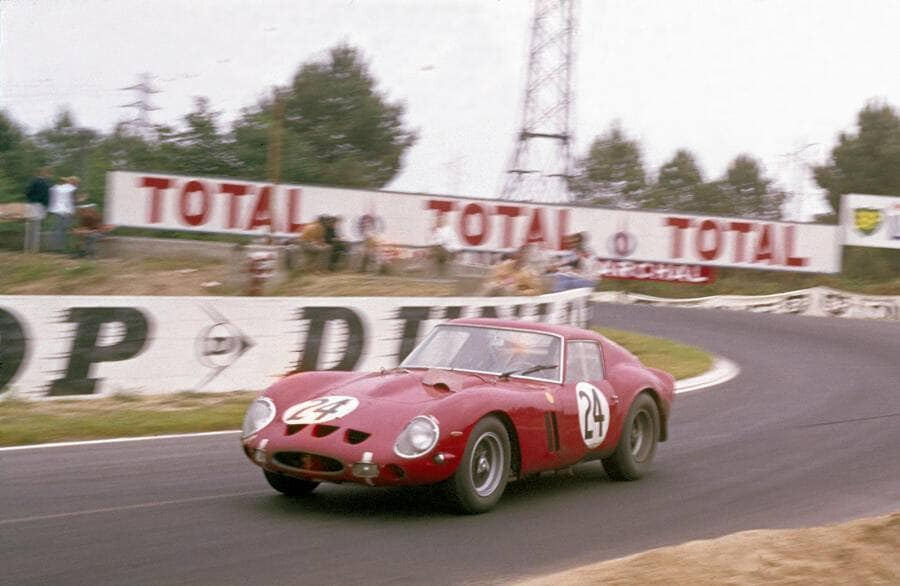 The Ferrari 250 GTO, driven by Jean Blaton (Beurlys) and Langlois von Ophem exiting Mulsanne Corner during the 25 Hours of Le Mans race, Le Mans, June 1963. The car, entered by Ecurie Francorchamps, finished second overall and first in GT. (Photo by Klemantaski Collection/Getty Images)