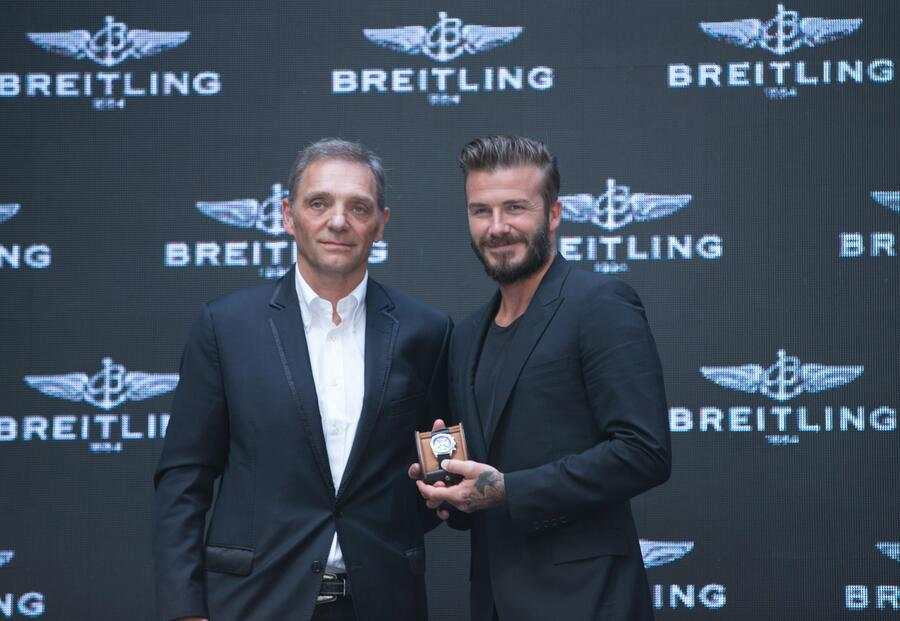President and CEO of Breitling SA Theodore Schneider (L) and David Beckham attend a commerical event on June 12, 2014 in Beijng, China