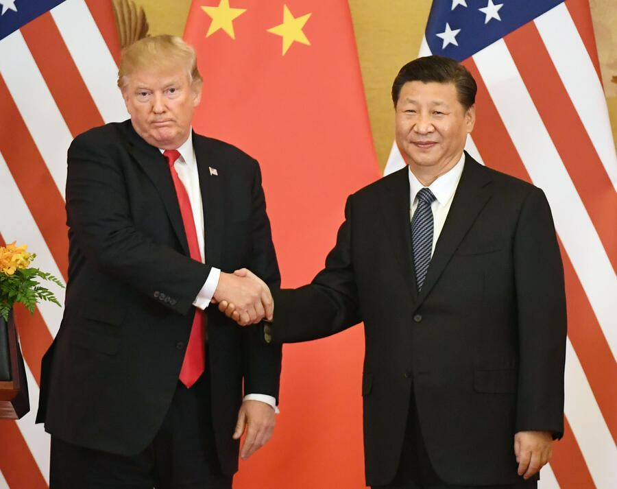 Photo taken in Nov. 9, 2017, shows U.S. President Donald Trump (L) and Chinese President Xi Jinping shaking hands during a joint press conference at the Great Hall of the People in Beijing. (Kyodo)==Kyodo(Photo by Kyodo News via Getty Images)
