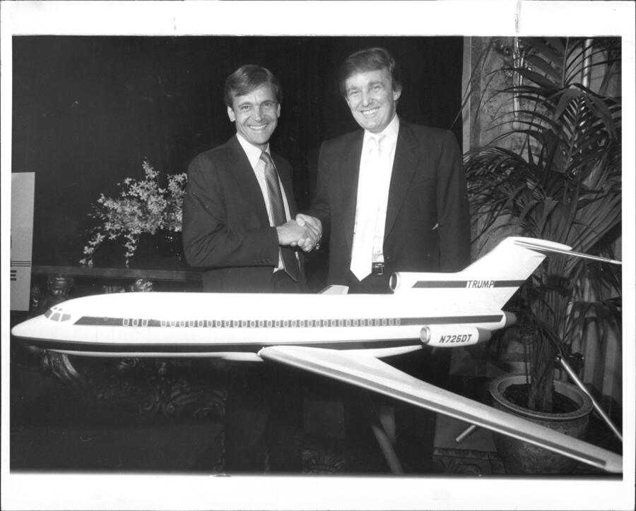 Donald Trump poses with Frank Lorenzo, owner of Eastern Air Lines Shuttle, and a model of the Trump jetliner. October 12, 1988. (Photo by Michael Schwartz/New York Post Archives /(c) NYP Holdings, Inc. via Getty Images)