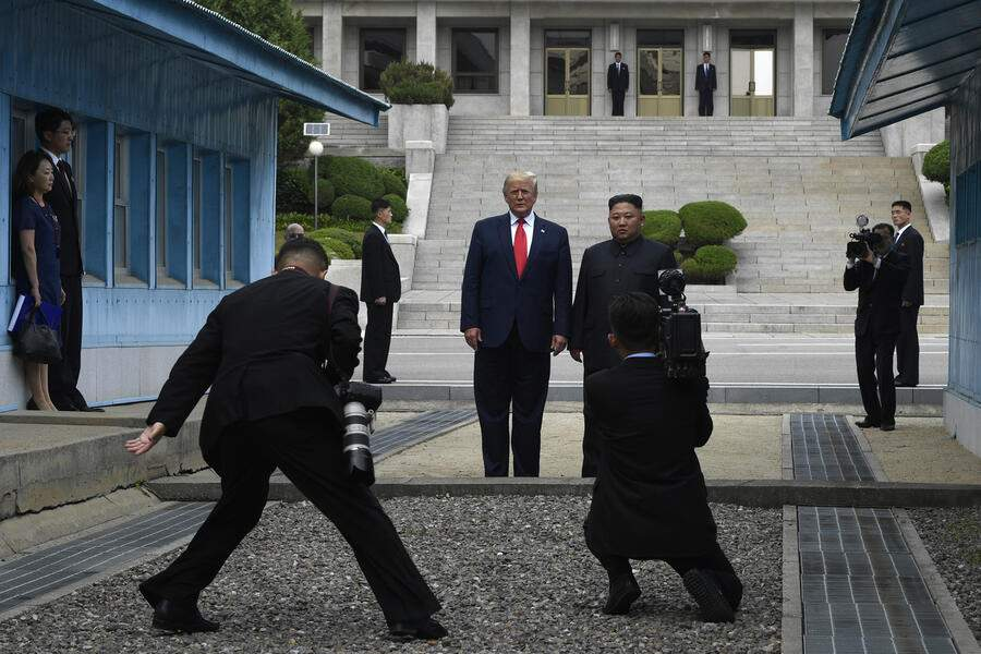 President Donald Trump stands with North Korean leader Kim Jong Un at the border village of Panmunjom in Demilitarized Zone, in North Korea, Sunday, June 30, 2019. (AP Photo/Susan Walsh)