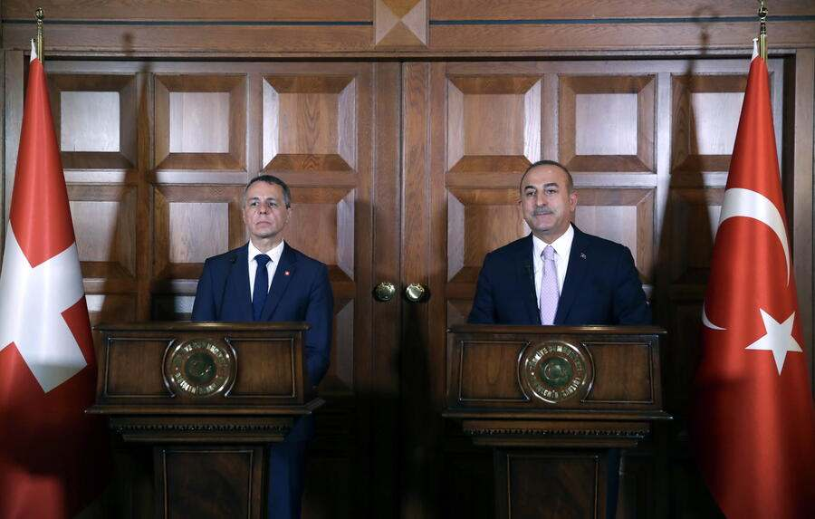 epa07711799 A handout photo made available by the Turkish Foreign Ministry press office shows Turkish Foreign Minister Mevlut Cavusoglu (R) and Swiss Foreign Minister Ignazio Cassis (L) speaking during a press conference after their meeting in Ankara, Turkey, 12 July 2019. EPA/CEM OZDEL HANDOUT HANDOUT EDITORIAL USE ONLY/NO SALES
