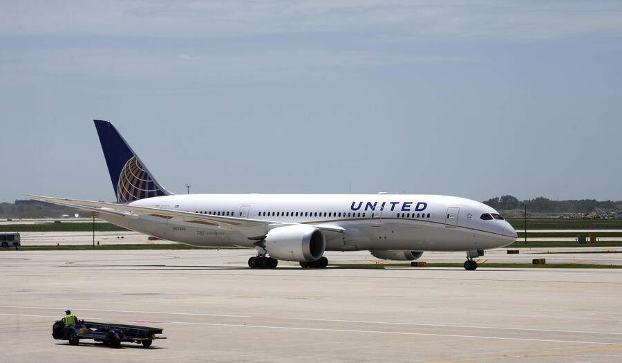 United Airlines Flight # 1 a Boeing 787 Dreamliner aircraft from Houston, Texas, taxis to the gate after landing at Chicago's O'Hare International Airport Monday, May 20, 2013.  The planes are returning after being grounded for four months by the federal government because of smoldering batteries on 787s owned by other airlines. (AP Photo/Charles Rex Arbogast)