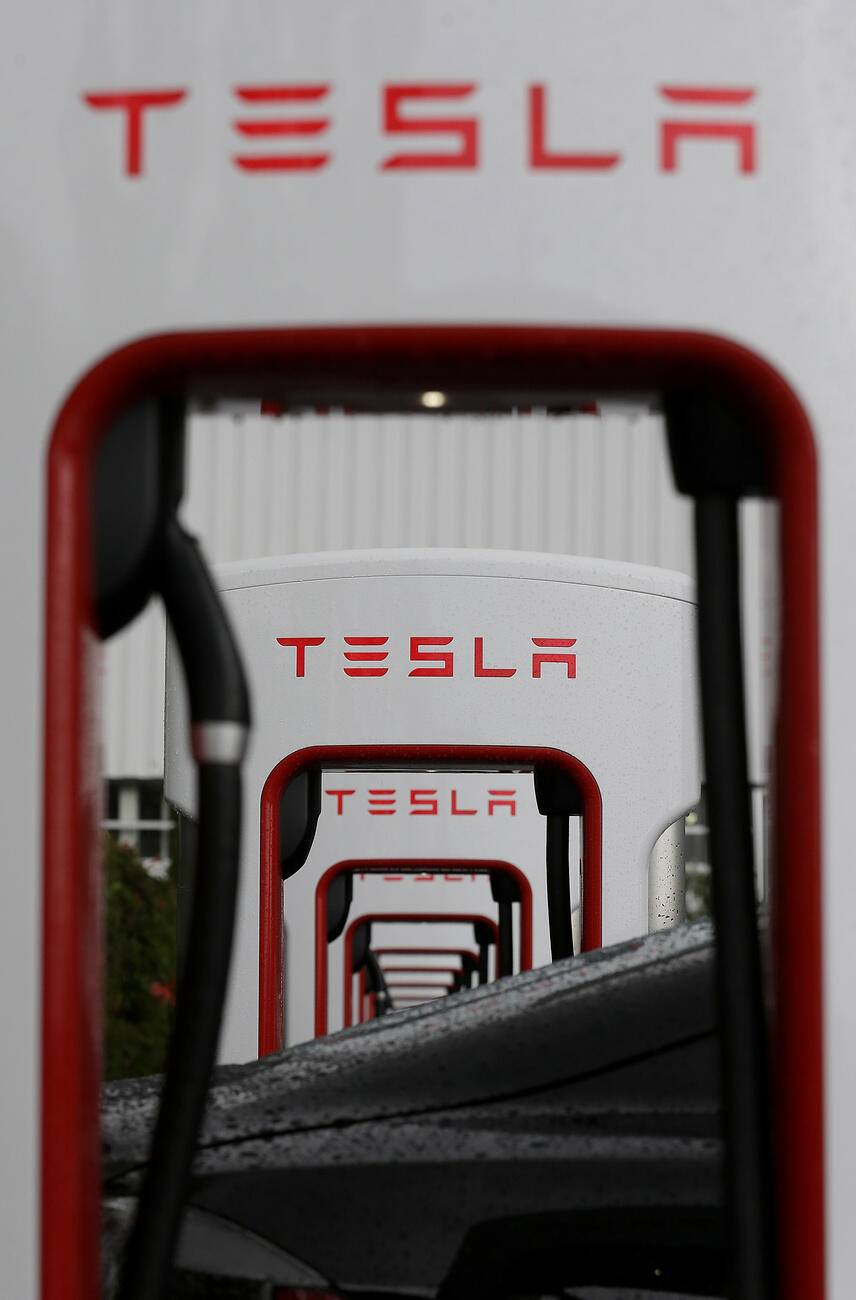 Tesla charging stations are shown outside of the Tesla factory in Fremont, Calif., Thursday, May 14, 2015. (AP Photo/Jeff Chiu)