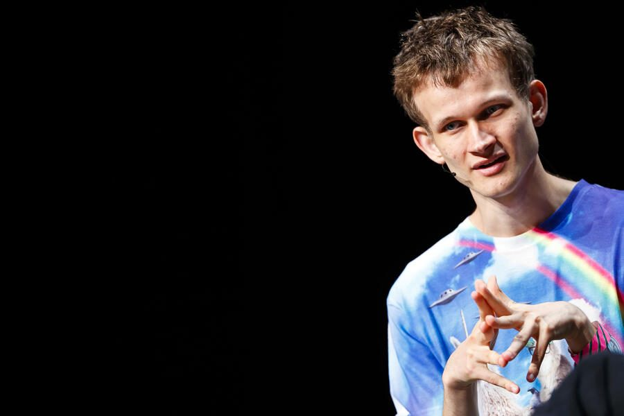 Russian-Canadian programmer Vitalik Buterin, founder and inventor of the Ethereum mining network and software development platform, along with the associated Ether (ETH) cryptocurrency, speaks at a blockchain event in Zug, Switzerland, Friday, July 6, 2018. (KEYSTONE/ Valentin Flauraud)