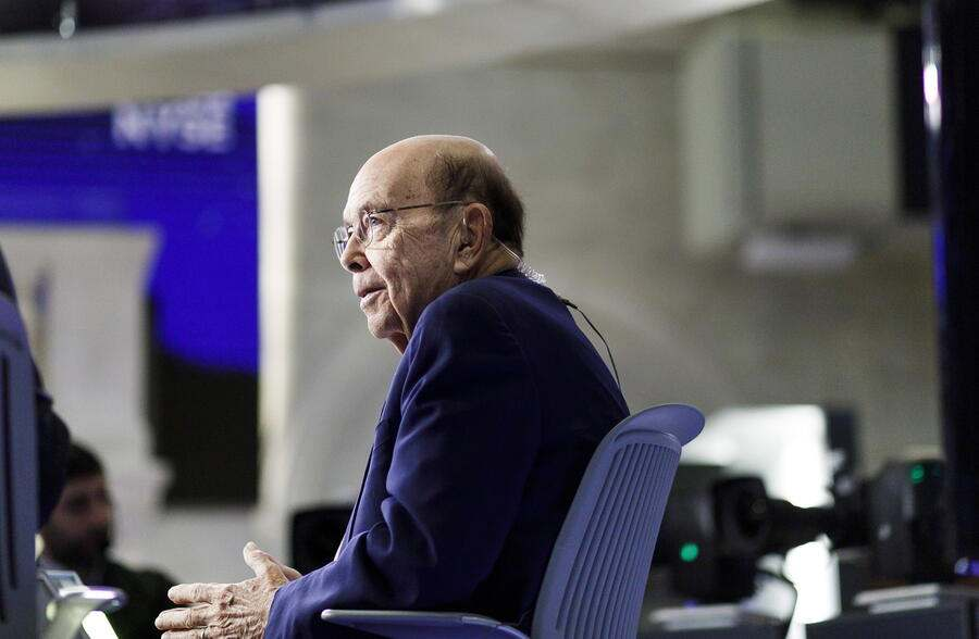 epa08041868 US Secretary of Commerce Wilbur Ross is interviewed at the New York Stock Exchange in New York, New York, USA, 03 December 2019. World markets reacted on 03 December to pessimistic comments from US President Donald Trump, seen on a television screen live in London, England, about a timeline for settling an ongoing trade dispute with China and a potential new trade disagreement with France. EPA/JUSTIN LANE