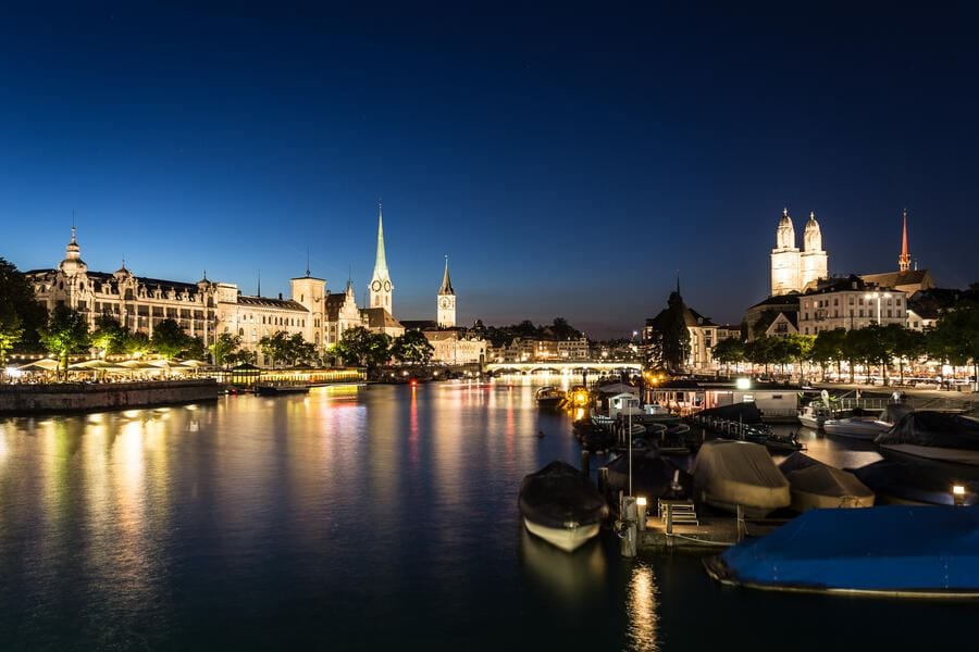 Night view of the Zurich old town and the Limmat river in Switzerland largest city