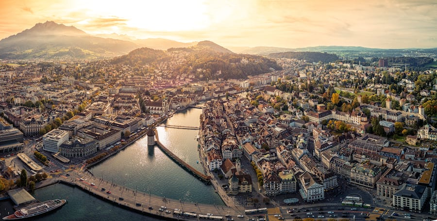 Panoramic photo of the beautiful Chapel bridge, Reuss River, and the Lucerne streets and buildings under the glorious sunset, taken in the city of Lucerne, Switzerland.  10/2017Photo taken by Drone device.