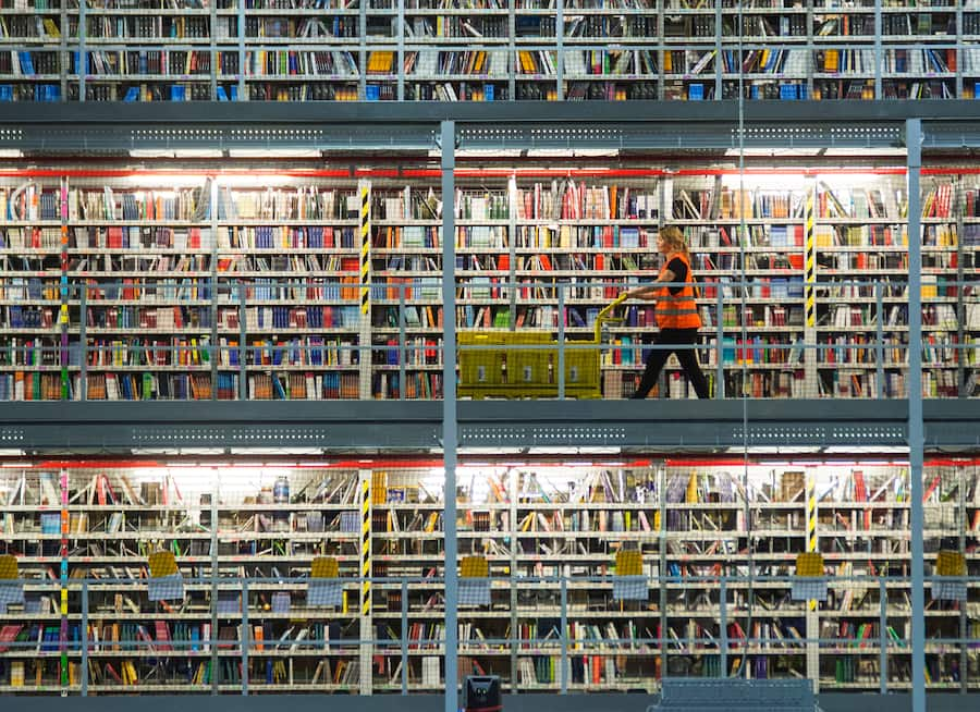 An employee works in the distribution center of the online retailer Amazon during a guided press tour prior to the upcoming Christmas business in Leipzig, central Germany, Thursday, Nov. 19, 2015. Amazon has more than 285 million active customer accounts worldwide. (KEYSTONE/AP Photo/Jens Meyer)