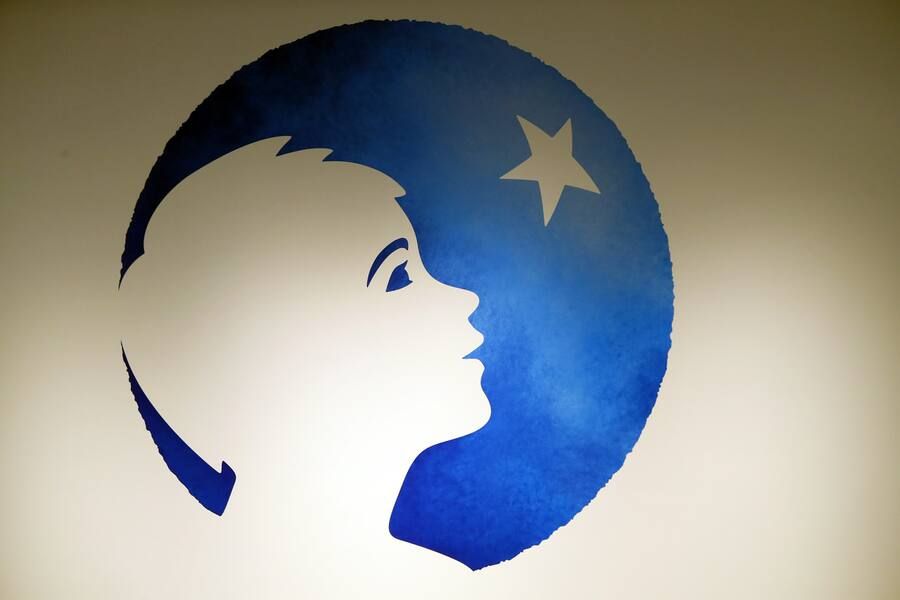 The logo of Danone company is displayed prior to the company's 2018 annual results presentation in Paris, Tuesday, Feb. 19, 2019. (AP Photo/Francois Mori)