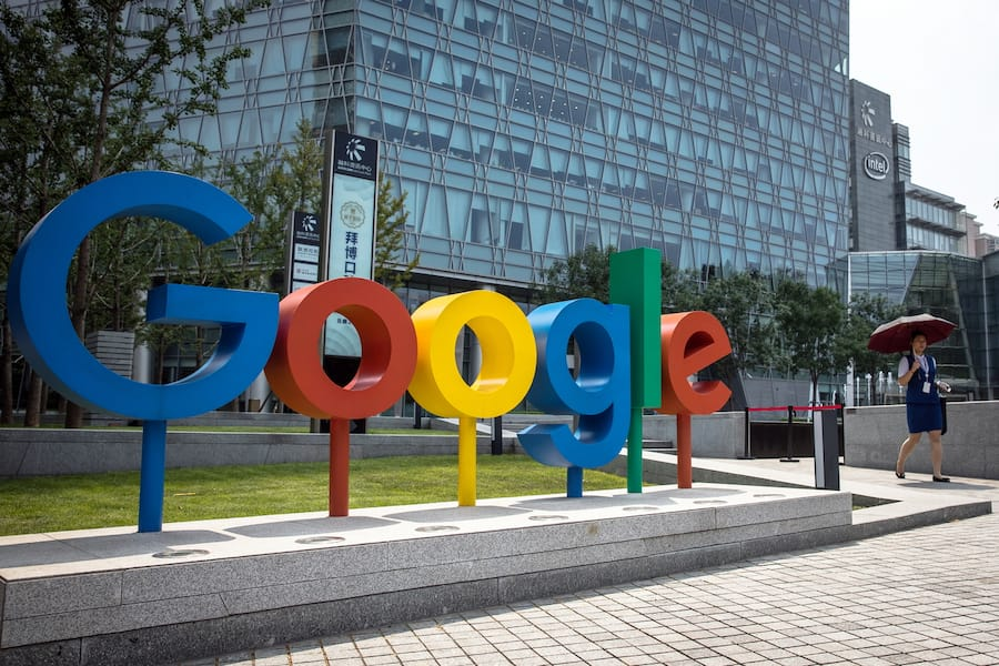 epa06994628 (FILE) - A Chinese woman walks past a 'Google' brand name and logo, near the Google office in Beijing, China, 03 August 2018 (reissued 03 September 2018). Google marks its 20th anniversary on 04 September 2018, the date in 1998 when Google founders Larry Page and Sergey Brin incorporated the company. The stock market value of Alphabet (parent company of Google) currently is 688 billion USD.  EPA/ROMAN PILIPEY
