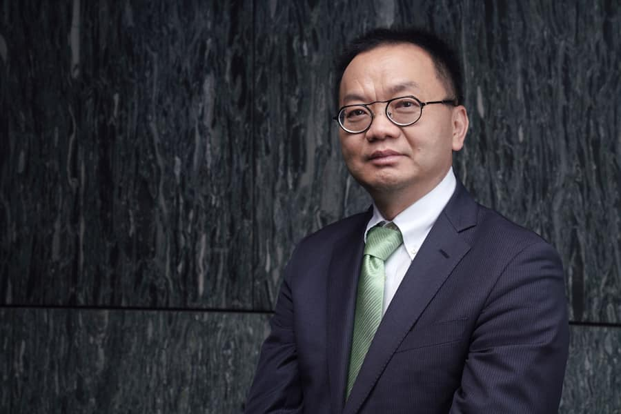 Chris Chen, chief executive officer of WuxiBiologicsCayman Inc., poses for a photograph at the Bloomberg Invest Asia forum in Hong Kong, China, on Thursday, March 21, 2019. The forum brings together some of the biggest businesses and influential institutions. Photographer: Anthony Kwan/Bloomberg