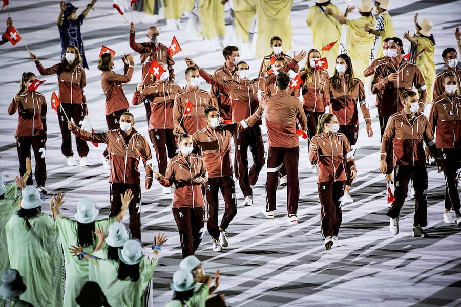 Swiss athletes parade during the opening ceremony of the 2020 Tokyo Summer Olympics at the National Stadium in Tokyo, Japan, Friday, July 23, 2021. (KEYSTONE/Laurent Gillieron)