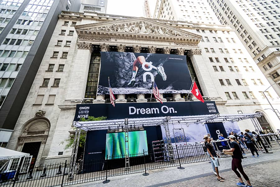 The facade of the New York Stock Exchange is decorated for the initial public offering of On Holdings, the sneaker manufacturer, on Wednesday, September 15, 2021. Roger Federer is reported to be an investor in the company. (© Richard B. Levine)