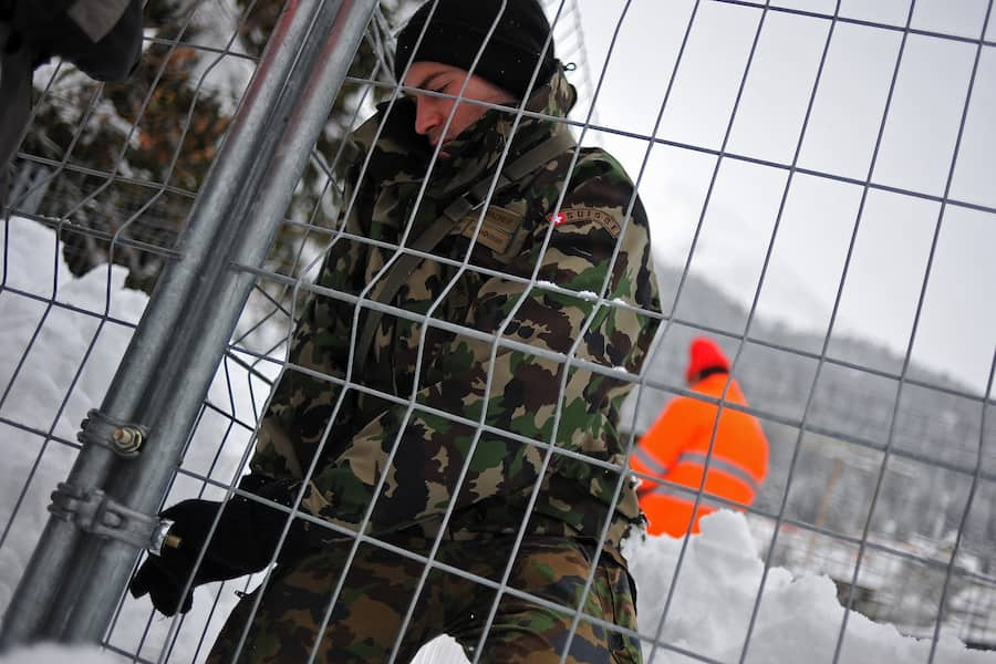 DAVOS, SWITZERLAND - JANUARY 10:  A Swiss army soldier installs fences on January 10, 2012 in Davos, Switzerland. The World Economic Forum, which gathers the World's top leaders, runs from January 25 - 29.  (Photo by Harold Cunningham/Getty Images)